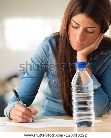 Portrait Of A Young Woman Writing On White Background