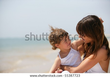 Portrait of a young women with a little girl in her arms