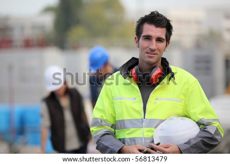 Portrait of a young worker on a site