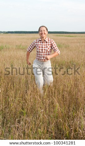 Portrait of active mature woman against summer day