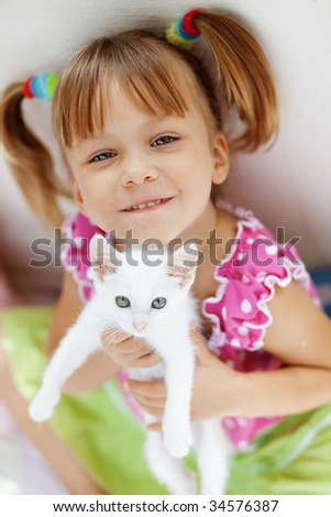 Portrait of adorable child with kitten
