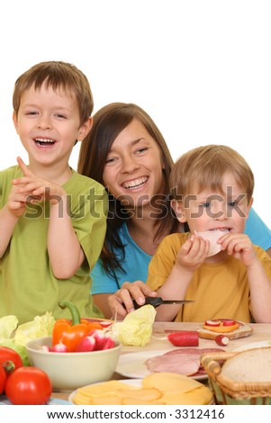 portrait of adorable family mother and sons having breakfast together isolated on white