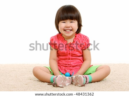 Portrait of adorable girl with smiling sitting on the floor
