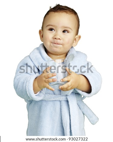 portrait of adorable infant with blue bathrobe holding a glass