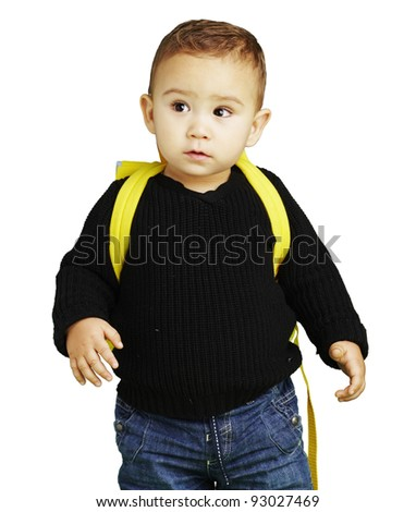 portrait of adorable kid carrying yellow backpack over white bacground