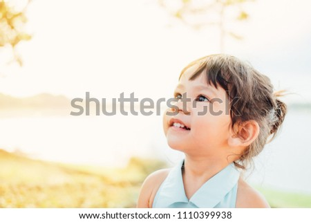 Portrait of adorable little asian girl showing front teeth with big smile, Healthy happy funny smiling face young adorable lovely female kid, Funny little child