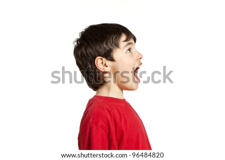 Portrait of adorable little boy, isolated on white background, side view