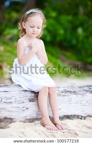 Portrait of adorable little girl outdoors