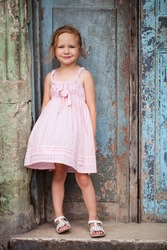 Portrait of adorable little girl outdoors on a street of old Havana