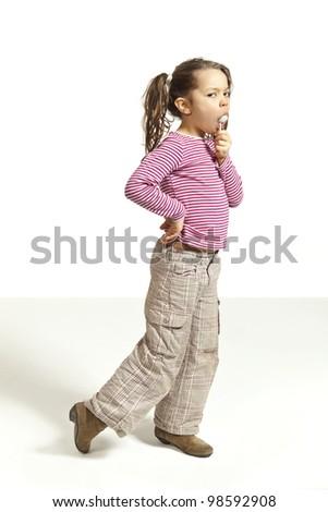 portrait of adorable little girl with a lollipop