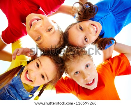 Portrait of adorable schoolkids touching their heads and looking at camera