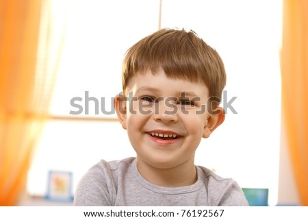 Portrait of adorable small boy looking at camera.?
