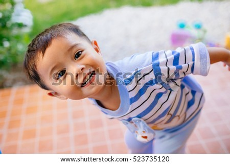 Portrait of adorable toddler asian little boy looking into something and happy Education concept.