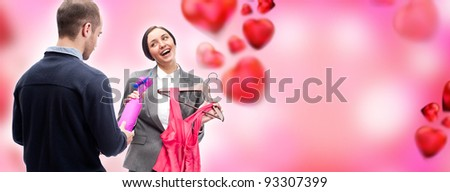 Portrait of adult business man and woman preparing to corporate party. Man gifting cute dress and wine to his colleague. Office romance concept. Romantic background with graphic hearts