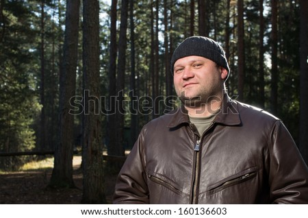 Portrait of adult caucasian man in the forest