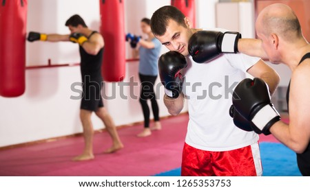 Portrait of adult sportsmen competing in boxing gloves