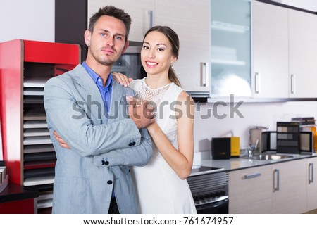 Portrait of adutl couple which is posing in kitchen furnishing store.  Stock photo ©