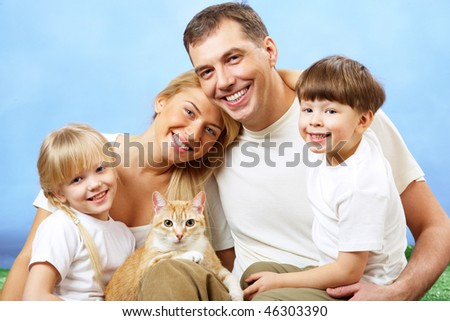 Portrait of affectionate family members looking at camera on blue background