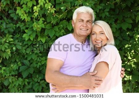Portrait of affectionate senior couple in park