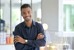 Portrait of african american businessman in co-working office