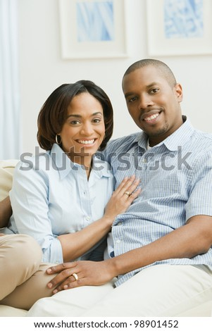 Portrait of African American couple on sofa