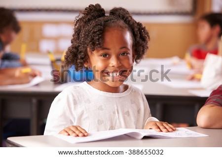 Portrait of African American elementary school girl in class