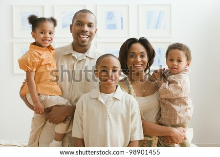 Portrait of African American family indoors