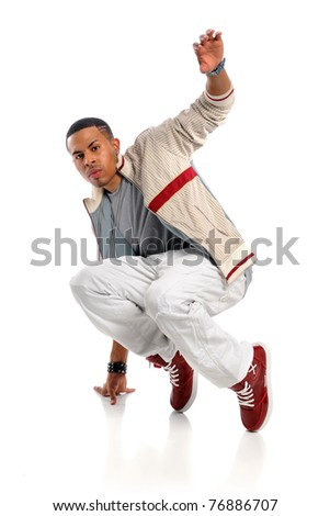 Portrait of African American hip hop dancer performing isolated over white background