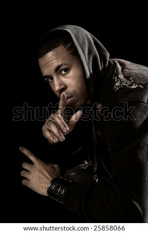Portrait of African American man with hood over a black background