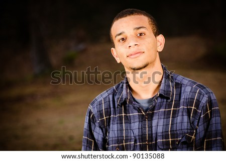Portrait of African-American teenager outdoors at park