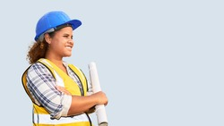 Portrait of African American woman architect wearing a vest and helmet on isolated background.
