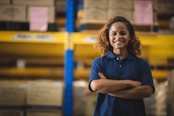 Portrait of African American worker in warehouse, International export business concept