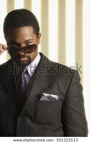 Portrait of African businessman wearing sunglasses