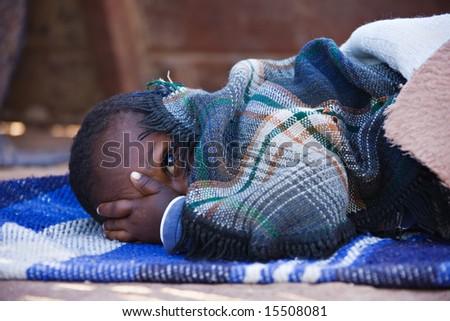 Portrait of African child sleeping in the yard , location Mmankodi village , Botswana