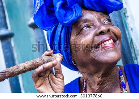 Photo of  Portrait of african cuban woman smoking cigar in Havana, Cuba
