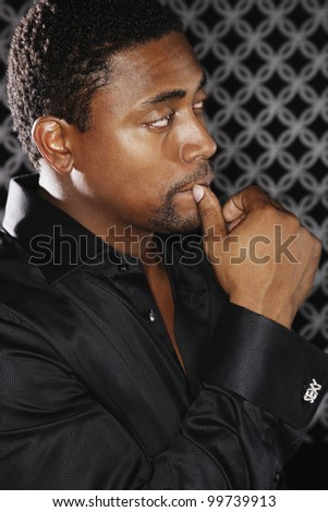 Portrait of African man with hand up to mouth