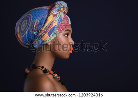 Portrait of African woman with a colorful traditional shawl on her head