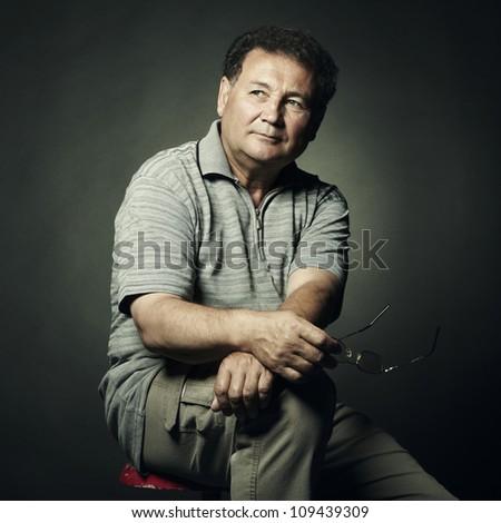 Portrait of aged man close up. Studio photo