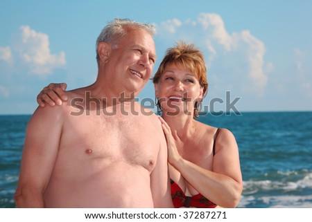 portrait of aged  pair against sea