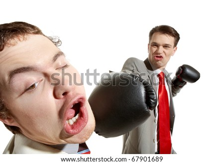 Portrait of aggressive businessman in boxing gloves kicking his rival