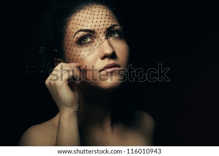 Portrait of alluring beautiful young women in veil closeup