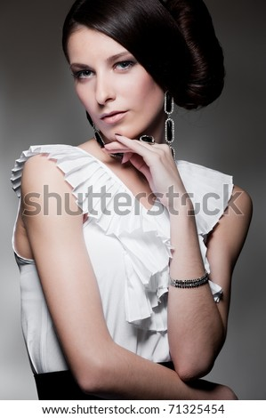 portrait of alluring woman over dark background