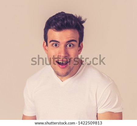 Portrait of Amazed excited young latin man pointing at something amazing laughing and making surprise gestures not believing his luck. In Happy face expression and Human emotions happiness.