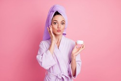 Portrait of amazed funny girlish cheery housewife wearing towel turban on hair applying night cream pout lips isolated on pink color background