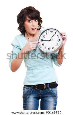 portrait of amazed woman with clock over white background