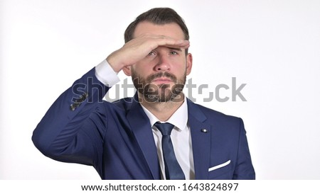 Portrait of Ambitious Young Businessman Searching for Opportunities, White Background