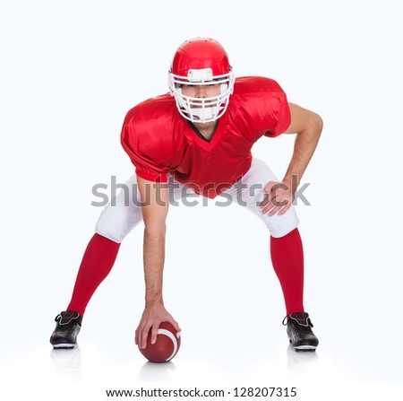 Portrait of American Football player. Isolated on white