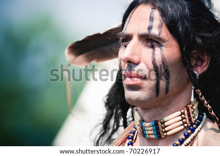 Portrait of american indian in national dress