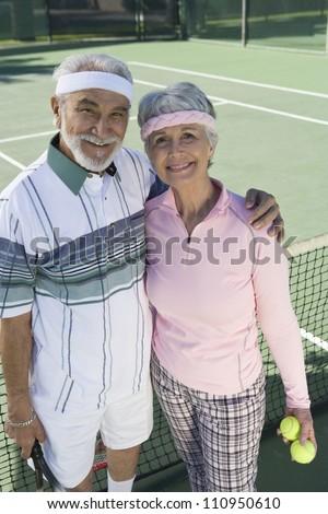 Portrait of an active senior couple on the tennis court