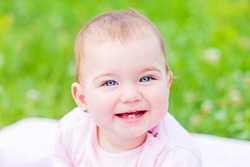Portrait of an adorable and cheerful baby girl